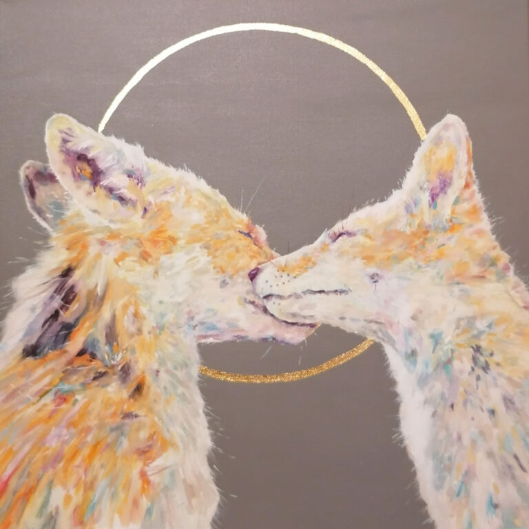 2 painted foxes cuddling