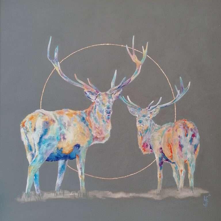 2 painted, colourful deers